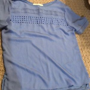 Blue short sleeve top with eyelets
